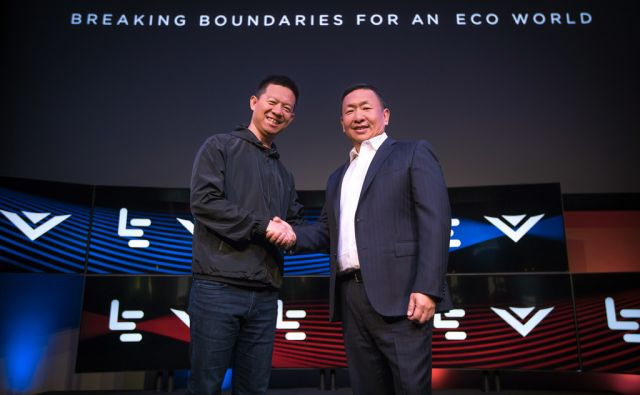 IMAGE DISTRIBUTED FOR LEECO - LeEco CEO YT Jia, left, and VIZIO CEO William Wang, right, shake hands at the LeEco and VIZIO Press Conference in Hollywood where it was announced that LeEco had acquired VIZIO for $2 billion, Tuesday, July 26, 2016 in Los