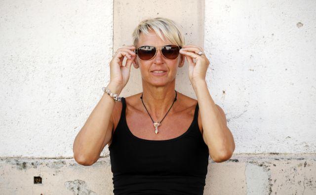 Brigita Bukovec, nekdanja atletinja in dobitnica olimpijske medalje, v Ljubljani, 2. avgusta 2016. [Brigita bukovec,atletika,atletinja,olimpijada,medalje,olimpijske igre]