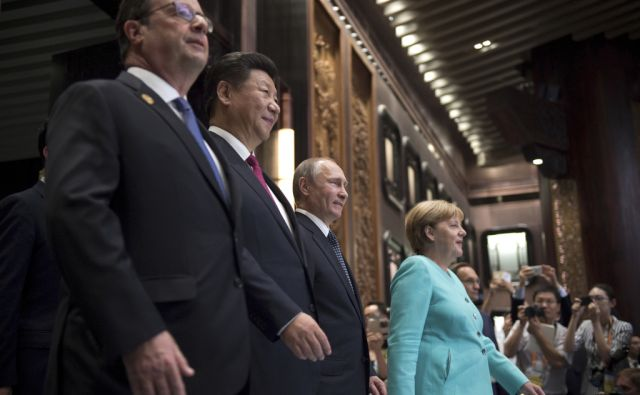 From left, French President Francois Hollande, Chinese President Xi Jinping, Russia's President Vladimir Putin and German Chancellor Angela Merkel arrive for the opening ceremony of the G20 Leaders Summit in Hangzhou, in China's eastern Zhejiang province
