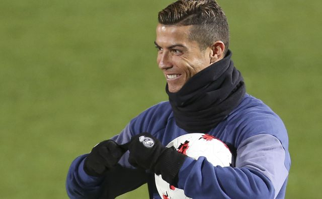 Real Madrid's Cristiano Ronaldo smiles before a training session at the FIFA Club World Cup soccer tournament in Yokohama, near Tokyo, Tuesday, Dec. 13, 2016. Real Madrid and Club America will play in the Dec. 15 semifinal. (AP Photo/Shizuo Kambayashi)