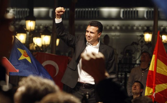 Zoran Zaev, the leader of the opposition SDSM celebrates wit the supporters in front of the government building, claiming victory on a general election in Skopje, Macedonia, late Sunday, Dec. 11, 2016. SDSM claims victory over, as they say, their party