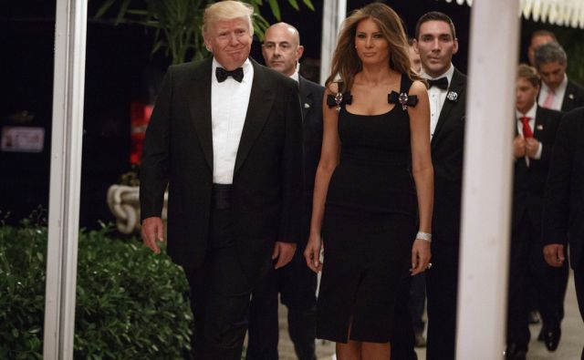 President-elect Donald Trump, left, and his wife Melania Trump arrive for a New Years Eve party at Mar-a-Lago, Saturday, Dec. 31, 2016, in Palm Beach, Fla. (AP Photo/Evan Vucci)