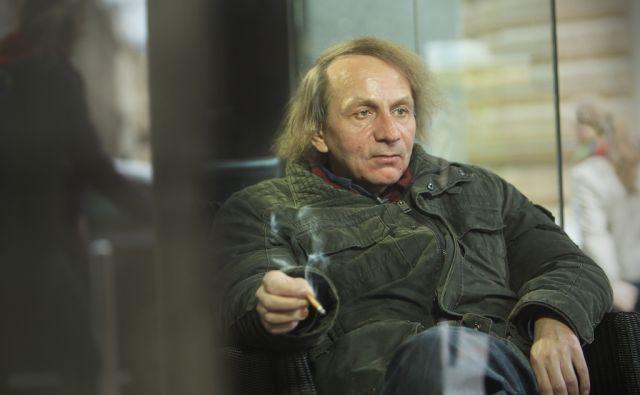 Francoski pisatelj Michel Houellebecq pred hotelom Slon v Ljubljani 27.marca 2014.