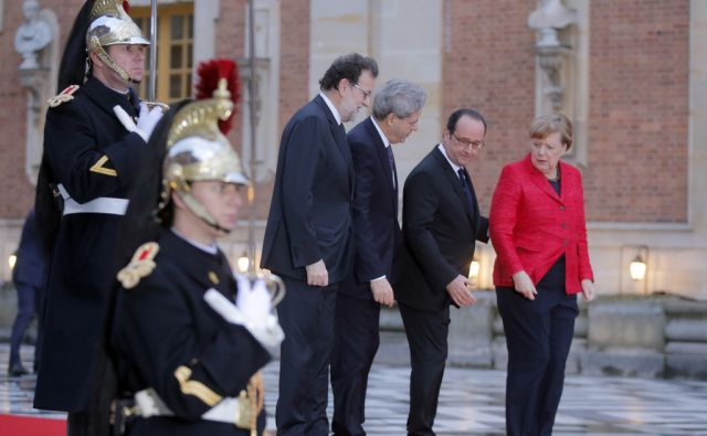 From left to right : Spanish Prime Minister Mariano Rajoy, Italian Prime Minister Paolo Gentiloni, French President Francois and German Chancellor Angela Merkel pose for photographers prior to their meeting at the Versailles castle, near Paris, France,