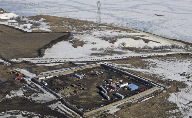 FILE - In this Feb. 13, 2017, aerial file photo shows the site where the final phase of the Dakota Access Pipeline will take place with boring equipment routing the pipeline underground and across Lake Oahe to connect with the existing pipeline in Emmons
