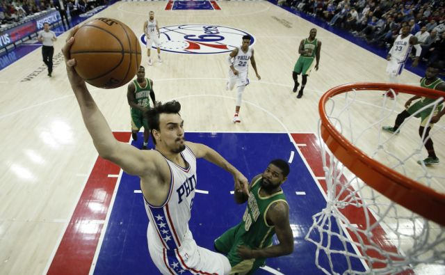 Philadelphia 76ers' Dario Saric, left, goes up for a shot against Boston Celtics' Amir Johnson during the second half of an NBA basketball game, Sunday, March 19, 2017, in Philadelphia. Philadelphia won 115-99. (AP Photo/Matt Slocum)