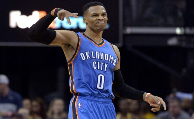 Oklahoma City Thunder guard Russell Westbrook (0) reacts after scoring a 3-pointer in the second half of an NBA basketball game against the Memphis Grizzlies Wednesday, April 5, 2017, in Memphis, Tenn. (AP Photo/Brandon Dill)