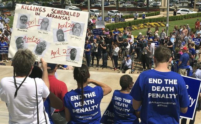 Protesters gather outside the state Capitol building on Friday, April 14, 2017, in Little Rock, Ark., to voice their opposition to Gov. Asa Hutchinson's plan to put seven men to death between April 17, and April 27, 2017. Hundreds showed up for the