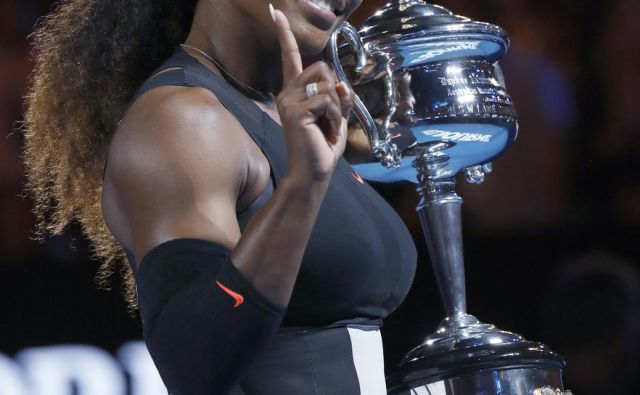 United States' Serena Williams smiles as she holds her trophy after defeating her sister, Venus, in the women's final at the Australian Open tennis championships in Melbourne, Australia, Saturday, Jan. 28, 2017. (AP Photo/Kin Cheung)