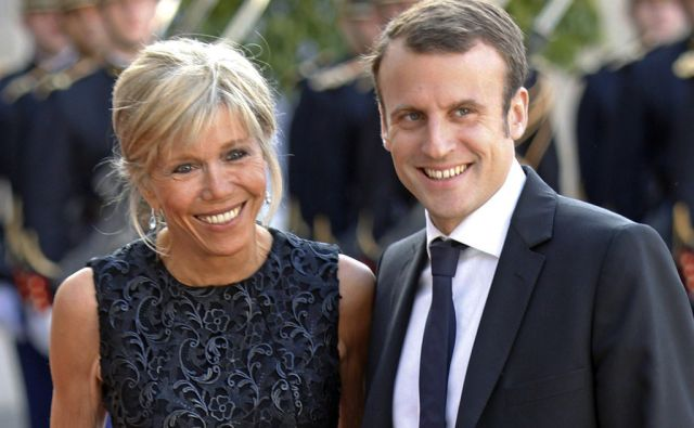 France's Economy Minister Emmanuel Macron and his wife Brigitte Trogneux pose for photographers as they arrive at the Elysee Palace in Paris, France, Tuesday, June 2, 2015. (AP Photo/Jacques Brinon)