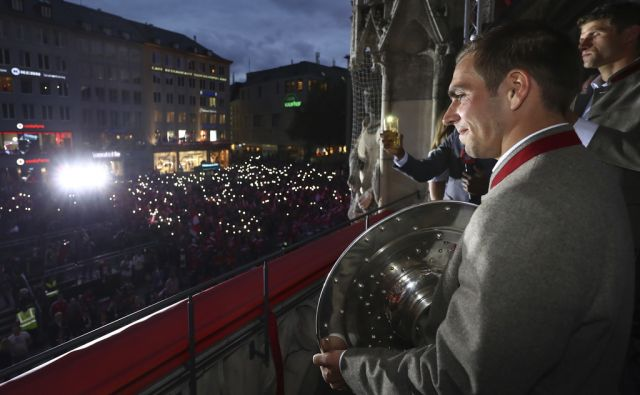 Philipp Lahm of Bayern Muenchen celebrates winning the 67th German Championship title on the town hall balcony at Marienplatz on May 20, 2017 in Munich, Germany.