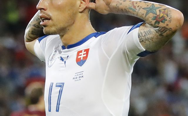 Slovakia's Marek Hamsik celebrates after scoring his side's second goal during the Euro 2016 Group B soccer match between Russia and Slovakia at the Pierre Mauroy stadium in Villeneuve d'Ascq, near Lille, France, Wednesday, June 15, 2016. (AP