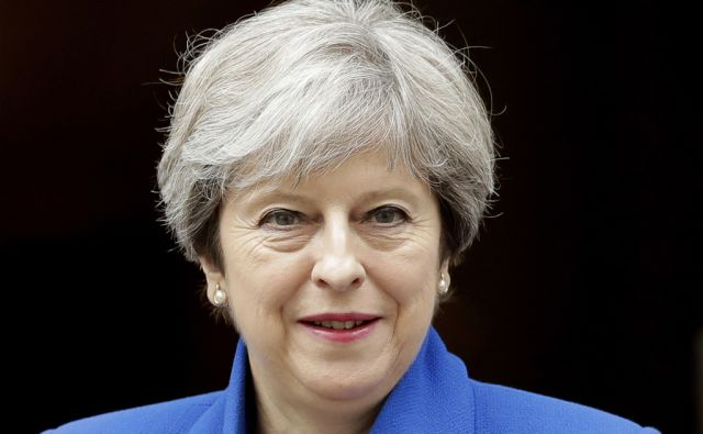 British Prime Minister Theresa May leaves 10 Downing Street in London, to attend Prime Minister's Questions at the Houses of Parliament, Wednesday, July 19, 2017.  (AP Photo/Matt Dunham)