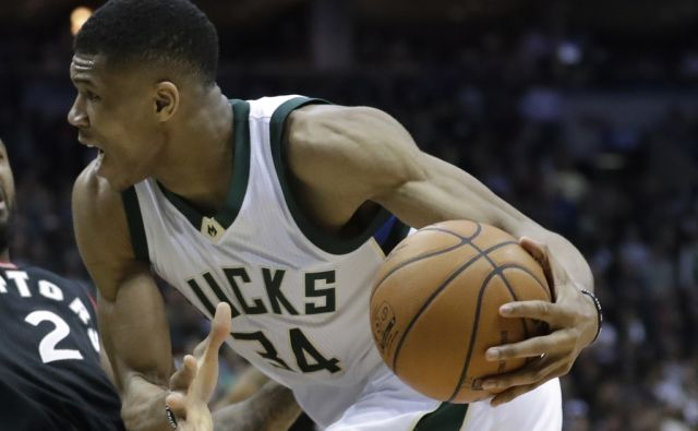 Milwaukee Bucks' Giannis Antetokounmpo runs into Toronto Raptors' DeMarre Carroll during the second half of Game 6 of an NBA first-round playoff series basketball game Thursday, April 27, 2017, in Milwaukee. The Raptors won 92-89 to win the series. (AP