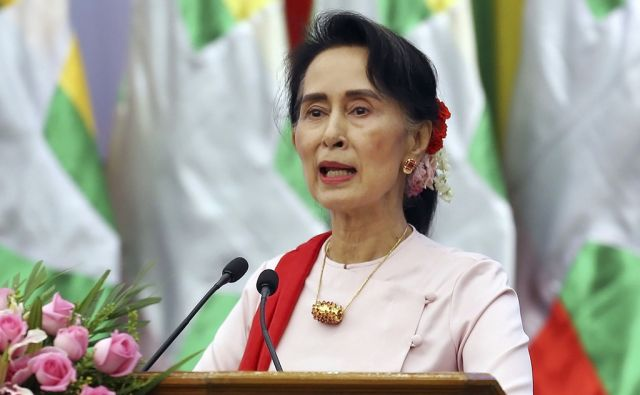 Myanmar's State Counsellor Aung San Suu Kyi delivers an opening speech during the Forum on Myanmar Democratic Transition at Myanmar International Convention Center in Naypyitaw, Myanmar, Friday, Aug 11, 2017. (AP Photo/Aung Shine Oo)