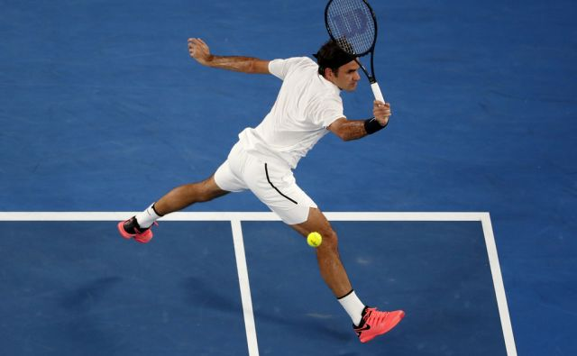 Switzerland's Roger Federer makes a backhand return to South Korea's Hyeon Chung during their semifinal at the Australian Open tennis championships in Melbourne, Australia, Friday, Jan. 26, 2018. (AP Photo/Ng Han Guan)