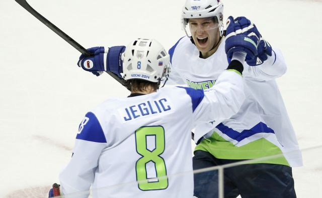 Slovenia forward Robert Sabolic (55) celebrates with Slovenia forward Ziga Jeglic after a second period goal against Russia during a men's ice hockey game at the 2014 Winter Olympics, Thursday, Feb. 13, 2014, in Sochi, Russia. (AP Photo/Mark Humphrey)