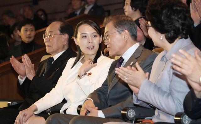 South Koran President Moon Jae-in, center right, talks with Kim Yo Jong, center left, North Korean leader Kim Jong Un's sister, as they watch a performance of North Korea's Samjiyon Orchestra at National Theater in Seoul, South Korea, Sunday, Feb. 11,