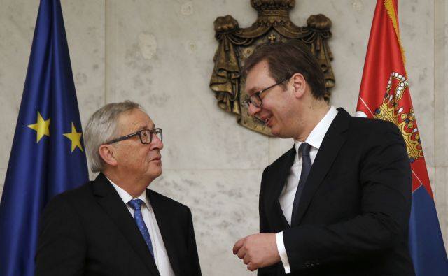 European Commission President Jean-Claude Juncker, left, speaks with Serbia's President Aleksandar Vucic in Belgrade, Serbia, Monday, Feb. 26, 2018. Juncker is on a Western Balkans tour that also includes stops in Albania, Serbia, Kosovo, Bosnia and