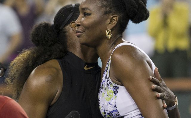 Venus Williams, right, hugs opponent and sister Serena Williams, left, after defeating Serena in the third round of the BNP Paribas Open tennis tournament at the Indian Wells Tennis Garden in Indian Wells, Calif., Monday, March 12, 2018. (AP