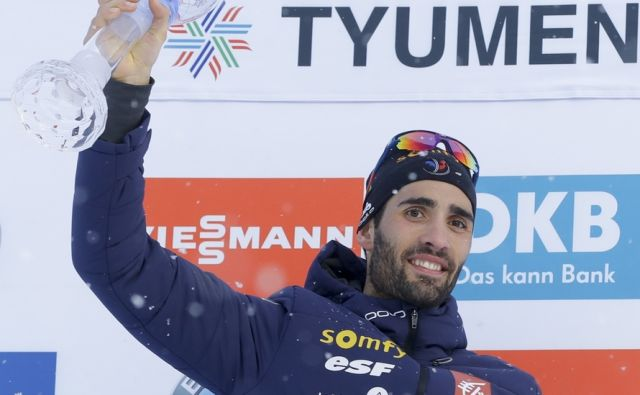 France's Martin Fourcade poses with the Biathlon World Cup overall trophy after completing the men's World Cup 15km mass start event, in Tyumen, Russia, Sunday, March 25, 2018. (AP Photo/Sergei Grits)