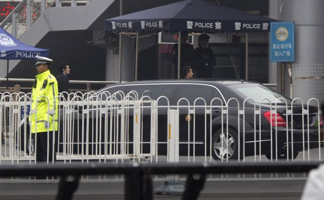 A limousine without car plates and bearing a gold color emblem on its side arrives amid heavy security at the train station in Beijing, China, Tuesday, March 27, 2018. The activity followed the arrival Monday of a train resembling one used by North